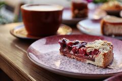 Plate with slice of cherry cake royalty free stock photo
