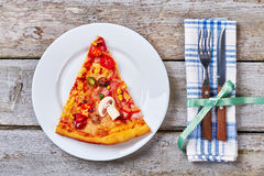 Plate with slice of pizza. Royalty Free Stock Images