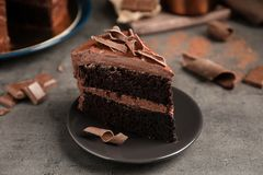 Plate with slice of tasty homemade chocolate cake. On table royalty free stock photo