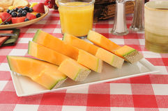 Sliced cantaloupe Stock Images