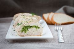 Plate of sliced chicken roll Stock Images