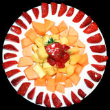 Plate of Sliced Fruit Stock Photography