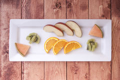 Plate of sliced fruit. Stock Photos