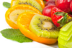 Plate with sliced fruits Stock Photo