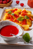 Plate of Sliced Peaches with Raspberry Sauce and Mint Leaf. Stock Photos