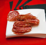 Plate with sliced of salami Stock Photo