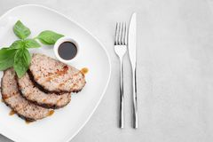Plate with sliced tasty turkey meatloaf. On table royalty free stock photos