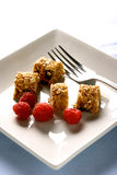 A plate of sliced up muesli bar royalty free stock photos