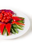 Plate with sliced vegetables. Cucumber, tomato, sweet pepper Royalty Free Stock Photos