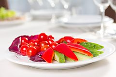 Plate with sliced vegetables. Cucumber, tomato, sweet pepper Royalty Free Stock Images