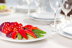 Plate with sliced vegetables. Cucumber, tomato, sweet pepper Stock Image