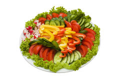 Plate of sliced vegetables isolated on white. Plate of sliced tomato, cucumber, salad, radish and yellow pepper isolated on white (with clipping path royalty free stock photography