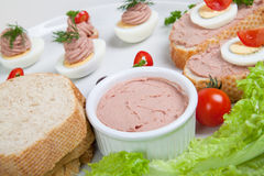 Plate with slices of bread with home made pate, decorated with vegetables Stock Photo