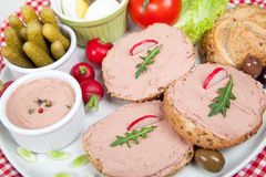 Plate with slices of bread with home made pate, with vegetables Stock Photography