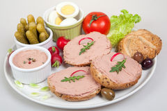 Plate with slices of bread with home made pate, with vegetables Stock Photos