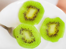 Plate with slices of kiwi fruit. Healthy diet. Stock Image