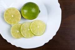 Plate with slices of lemon Stock Image