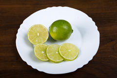 Plate with slices of lemon Stock Images