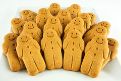 Plate of smiling gingerbread man cookies Royalty Free Stock Image