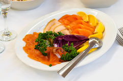 Plate with smoked fish Royalty Free Stock Photography