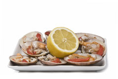 A plate of smooth clams with lemon Stock Photo