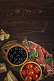 Plate with snack - prosciutto, jamon, ham. Royalty Free Stock Image