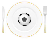 Plate and soccer ball Royalty Free Stock Image