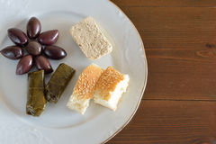 Plate with some food for fasting. Fasting food concept of plate with olives, dolma, halva and lagana Stock Photography