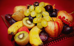 Plate with some Fruits. Like Banana, Apple and Strawberry royalty free stock image