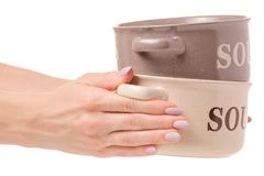 Plate for soup female hands isolated. On white background isolation Stock Photography