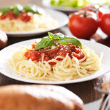 Plate of spaghetti with basil garnish. Royalty Free Stock Photos