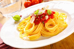 Plate Of Spaghetti Bolognese. Plate of freshly prepared spaghetti bolognaise with a tomato sauce and cheese ready to be served Stock Images