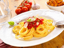 Plate Of Spaghetti Bolognese. Plate of freshly prepared spaghetti bolognaise with a tomato sauce and cheese ready to be served Stock Photography