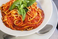 Plate of spaghetti bolognese with basil garnish Royalty Free Stock Image