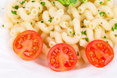 Plate of spaghetti with fresh cherry tomatoes Royalty Free Stock Images