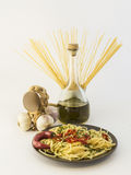 Spaghetti with garlic, oil and chilli. Plate of spaghetti with garlic, olive oil, chili pepper on white background Royalty Free Stock Photography