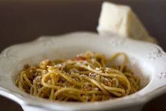 Plate of spaghetti with grated parmesan cheese on top royalty free stock photography