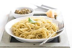 Plate of spaghetti with green pesto Royalty Free Stock Photos