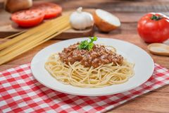 Plate of spaghetti and minced beef on the table in restaurant Stock Photo