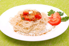 Plate of spaghetti with mushrooms and tomatoes Royalty Free Stock Photo