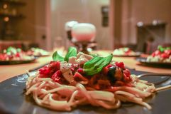 Plate of spaghetti pasta with tomato, basil and mozarella royalty free stock images