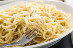 Plate of spaghetti with pesto and cheese, close-up Stock Photo