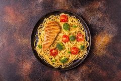 Plate of spaghetti tomato broccoli chicken royalty free stock images