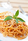 Plate of spaghetti in tomato sauce with basil Stock Photography