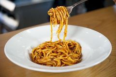 Plate of spaghetti with tomato sauce and basil. With fork ready to tasting Royalty Free Stock Image