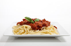 Plate of spaghetti on white Stock Images