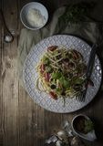 Plate of spaghetti on wooden Table royalty free stock images