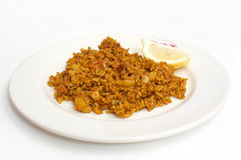 Plate with spanish traditional food - paella. On white background Royalty Free Stock Image