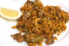Plate with spanish traditional food - paella. On white background Stock Image