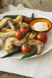 Plate of spicy chicken wings on table Stock Photography